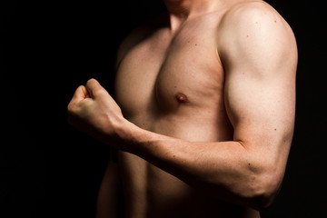 Naked male chest and detail of biceps