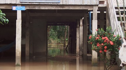 flood under the khmer house, cambodia,