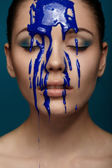 Woman with flowing blue paint