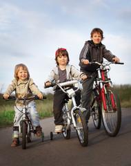 three brothers ride bikes