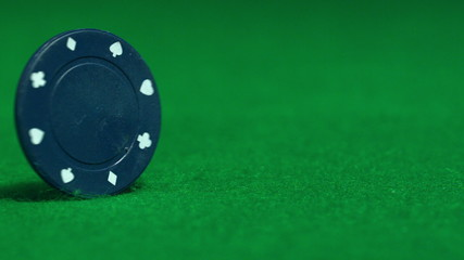 Blue chip spinning on casino table