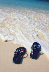 Aussie thongs on on the beach holiday