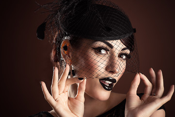 Model with Black Makeup in a veil