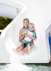 Family fun on the water slide at a waterpark