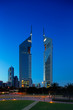 A profile of the iconic Emirates Towers in Dubai, UAE at dusk