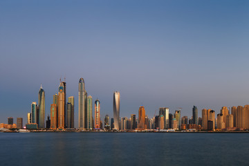 Dubai Marina at dusk as viewed from Palm Jumeirah in Dubai, UAE