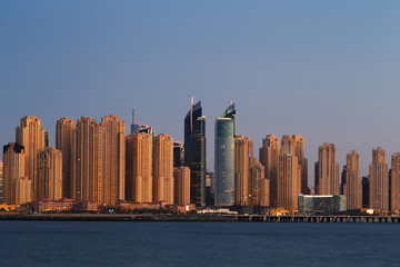 Dubai Marina at dusk as viewed from Palm Jumeirah in Dubai, UAE
