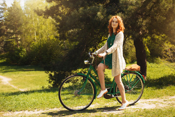 Red-hair woman riding a bicycle