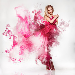 Gorgeous young adult blonde in pink dress with smoke