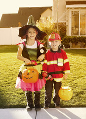 Halloween Trick-or-treaters at warm autumn sunset