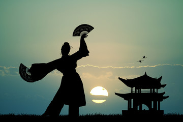 Chinese  dance at sunset