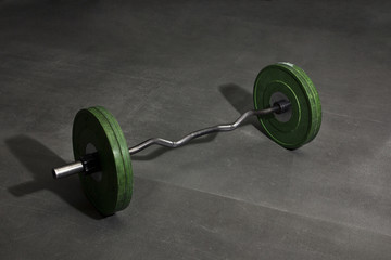 Heavy Barbell weight at the gym floor