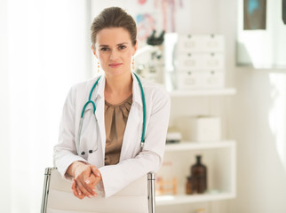 Portrait of happy medical doctor woman in office
