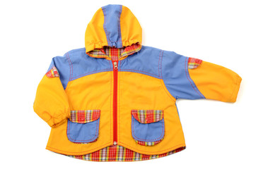 Close up on a newborn baby jacket, baby small colored coat