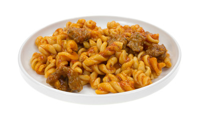 Plate of pasta with sausage in tomato sauce