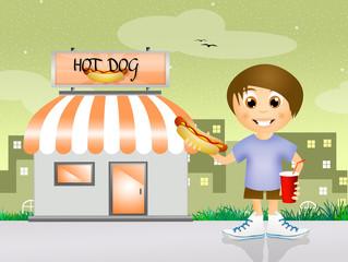 child eating hot dog