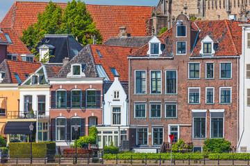 Old houses alongside the Dutch river IJssel in Deventer