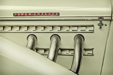 Retro styled image of the side view of a classic car