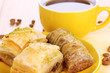 Sweet baklava on plate with tea close-up