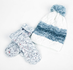 Winter cap and mittens, isolated on white