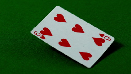 Six of hearts falling on casino table