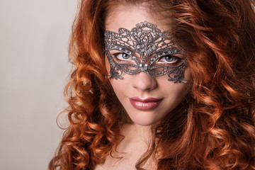 Beautiful Girl in a Carnival mask. Masquerade