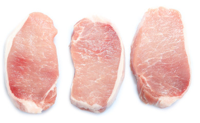 Raw meat steaks isolated on white