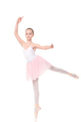 school age girl playing dress up wearing a ballet tutu