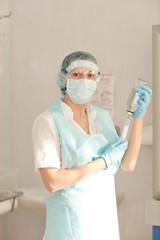 nurse prepares the system for intravenous infusion. intravenous