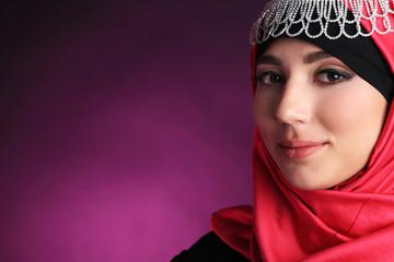 Beautiful muslim arabic woman on dark color background
