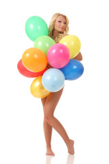 young girl is covered balloons
