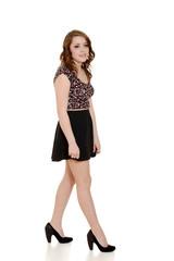 teen girl wearing short black skirt