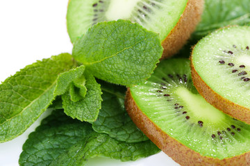Kiwi fruit with mint isolated on white