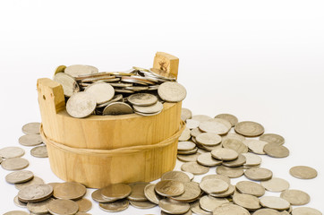 Stack of coin with wood bucket