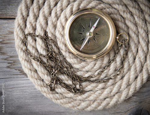 Antique compass and rope