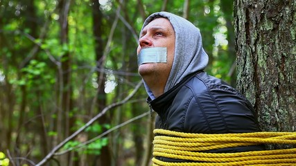 Man tied to a tree in the forest episode 7
