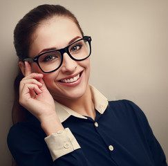 Happy business woman holding glasses and looking
