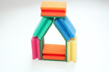 House shaped arrangement of scouring sponges isolated