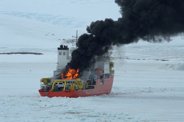 burning Icebreaker ship in the sea of Antarctic