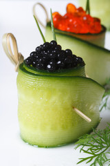 two cucumber rolls with red and black caviar