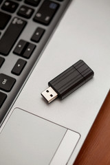 Flash drive on laptop keyboard