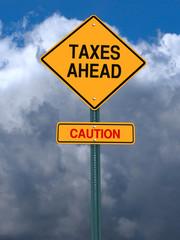 caution taxes ahead post sign