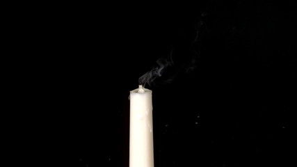 Arrow shooting through white candle