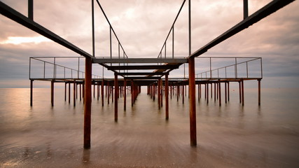 Old rusty pier and stormy clouds -timelapse