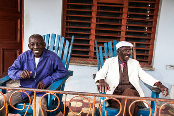 5: Happy elderly cuban men sits in veranda