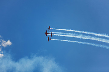 Three airplane fly across the sky