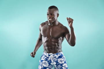Summer black african american muscled fitness man dancing. Weari