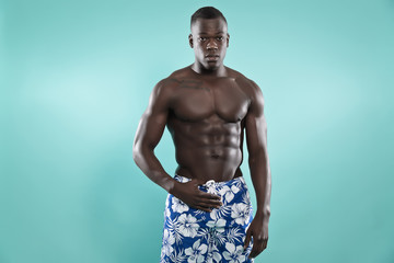 Black african american muscled fitness man. Summer swimwear fash