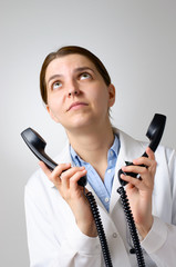Unhappy doctor with phone receivers