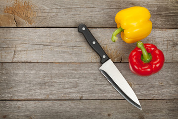 Colorful bell peppers and kitchen knife